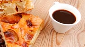 кофе в зернах : baked food : apple pie triangles served with hot coffee cup on wood table