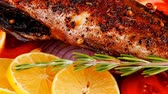 seabass : savory: whole fryed sunfish over wood with tomatoes lemons and peppers Stock Footage