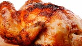 single roast : poultry : fresh grilled whole chicken on wooden cutting board 1920x1080 intro motion slow hidef hd Stock Footage