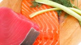 salmon pink : pieces of salmon and tuna fish on wooden plate 1920x1080 intro motion slow hidef hd Stock Footage