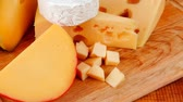 poroso : many delicious aged cheeses on wooden plate 1920x1080 intro motion slow hidef hd Vídeos