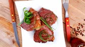 meal : grilled meat beef steaks strips plate with pepper and cutlery over wood table 1920x1080 intro motion slow hidef hd