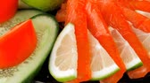 песто : salmon slices and tomatoes on black plate 1920x1080 intro motion slow hidef hd Стоковые видеозаписи