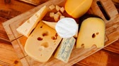 different cheeses : different cheeses served on wooding cutting board 1920x1080 intro motion slow hidef hd
