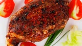 pimenta em grão : meat : grlled meat shoulder on plate with tomatoes green lettuce and cutlery 1920x1080 intro motion slow hidef hd