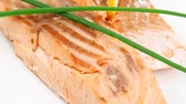 salmon pink : savory sea fish entree : roasted salmon fillet with green onion  and lemon plate 1920x1080 intro motion slow hidef hd Stock Footage