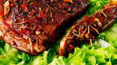 single roast : single served steak on raw green salad 1920x1080 intro motion slow hidef hd Stock Footage