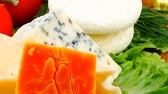sorts : roquefort with cheddar  parmesan and soft feta cheese on wooden board with tomatoes bread and olive oil 1920x1080 intro motion slow hidef hd Stock Footage