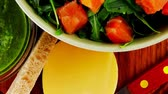 recipe : green salad with smoked salmon and bread in green bowl 1920x1080 intro motion slow hidef hd Stock Footage