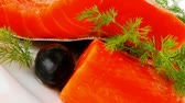salmon pink : sinlge pink salmon bit on a big white dish 1920x1080 intro motion slow hidef hd Stock Footage