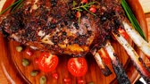 charbroiled : grilled ribs on wooden table with vegetables 1920x1080 intro motion slow hidef hd