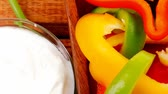 erva doce : raw peppers sliced on wooden table with sour cream 1920x1080 intro motion slow hidef hd
