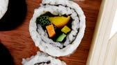 унаги : Japanese Cuisine - Maki Roll with Deep Fried Vegetables inside . on wooden plate . 1920x1080 intro motion slow hidef hd