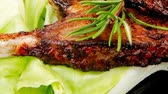 Флорес : served savory plate: meat ribs with chives and red hot peppers 1920x1080 intro motion slow hidef hd Стоковые видеозаписи