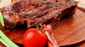 charbroiled : meat savory : grilled beef ribs served with green chives and cherry tomato over wood 1920x1080 intro motion slow hidef hd