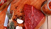 background : fresh raw beef meat fillet flesh with peppercorn and thyme ready to grill on wood figured old style board over table with spices in glass 1920x1080 intro motion slow hidef hd Stock Footage