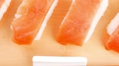 сакэ : Japanese traditional Cuisine - Set of Nigiri sushi topped with raw Salmon . Isolated 1920x1080 intro motion slow hidef hd Стоковые видеозаписи