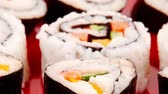 унаги : Japanese Traditional Cuisine - California Roll with Avocado and Salmon  Cream Cheese . on red dish with sticks 1920x1080 intro motion slow hidef hd