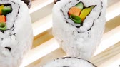 унаги : Maki Roll with Deep Fried Vegetables inside . on wooden grid . . Japanese Cuisine 1920x1080 intro motion slow hidef hd