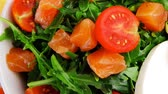 recipe : green salad with salmon and tomatoes in white bowl 1920x1080 intro motion slow hidef hd Stock Footage