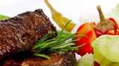bebekler : meat plate: grilled ribs plate with red hot peppers  tomatoes and chives 1920x1080 intro motion slow hidef hd