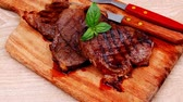 kitchen : grilled beef on wooden plate with cutlery over table 1920x1080 intro motion slow hidef hd