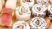 fumado : Japanese traditional Cuisine - Maki Roll with Cucumber   Cream Cheese and Raw Salmon inside served with Nigiri topped raw Salmon Tuna and Eel . Isolated 1920x1080 intro motion slow hidef hd Vídeos