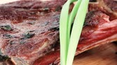 entrees : meat savory : grilled beef ribs served with green chives on wooden table 1920x1080 intro motion slow hidef hd Stock Footage