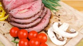 roast ham : hot ham on wooden plate served over wood table 1920x1080 intro motion slow hidef hd