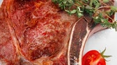 charbroiled : meat food : roast rib dish with thyme twig   pepper and tomato 1920x1080 intro motion slow hidef hd