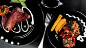 capers : fresh red beef meat steak barbecue garnished vegetable salad sweet potato and basil on black plate over black wooden table with bbq sauce in sauceboat 1920x1080 intro motion slow hidef hd