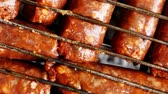 ribeye : grilled roast beef lamb sausages on bbq grid over charcoal 1920x1080 intro motion slow hidef hd