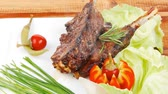 rozmaring : meat savory on wooden table: roast ribs plate with peppers lettuce tomato and chives 1920x1080 intro motion slow hidef hd