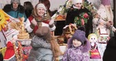торжества : Gomel, Belarus. Woman And Girl Is Photographed With Saleswoman Of Pancakes At Celebration Eastern Slavic National Traditional Holiday Maslenitsa. Winter Spring Holiday
