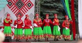 népi : Gomel, Belarus. Women Group In National Clothes Performing Folk Songs During Celebration Of Independence Day Of The Republic Of Belarus Stock mozgókép