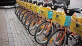 litwa : Vilnius, Lithuania. Row Of Colorful Bicycles AVIVA For Rent At Municipal Bike Parking In Street. Wideo
