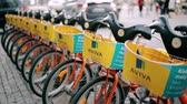 parked : Vilnius, Lithuania. Row Of Colorful Bicycles AVIVA For Rent At Municipal Bike Parking In Street. Stock Footage