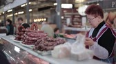 litwa : Vilnius, Lithuania. Woman Seller In Halle Market Sells Sausage And Other Meat Products. Seller Serves Buyer In Local Food Market. Wideo