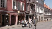 всемирного наследия : Vilnius, Lithuania. People Walking In Pilies Street In Sunny Spring Day. Famous Street In Old Town. UNESCO World Heritage Site