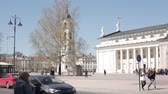 litwa : Vilnius, Lithuania. People Walking In Cathedral Square Near Cathedral Basilica Of St. Stanislaus And St. Vladislav With The Bell Tower In Spring Day Wideo