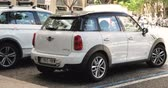 crossover : White Color Mini Cooper All 4 Car Parking In Street.