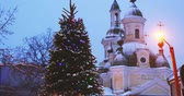 подсветкой : Parnu, Estonia. Christmas Tree In Holiday New Year Festive Illumination And St. Katherine Orthodox Church On Background Стоковые видеозаписи