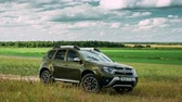 crossover : Gomel, Belarus - June 13, 2018: Renault Duster or Dacia Duster SUV in summer meadow landscape. Time Lapse, Timelapse, Time-lapse.