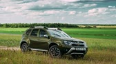 renault : Gomel, Belarus - June 13, 2018: Renault Duster or Dacia Duster SUV in summer meadow landscape. Time Lapse, Timelapse, Time-lapse.