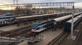belarus : Gomel, Belarus - April 18, 2018: People Boarding On Train On The Station Platform. Trains And Railway Station Building Stock Footage