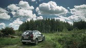 renault : Gomel, Belarus - Junly 5, 2018: Renault Duster SUV in summer forest landscape. Duster produced jointly by French manufacturer Renault. Time Lapse, Time-lapse Stock Footage