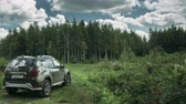 offroad : Gomel, Belarus - Junly 5, 2018: Renault Duster SUV in summer forest landscape. Duster produced jointly by French manufacturer Renault. Time Lapse, Time-lapse Stock Footage