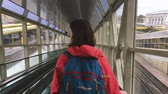 kolej : Minsk, Belarus. Young Woman Girl Is Riding An Escalator Down To Platform With Trains In The Minsk Railway Station