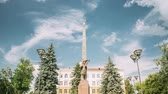 gomel : Gomel, Belarus. Monument To Heroes-members Of The Komsomol At Crossroads Of Streets Of Karpovicha And Zharkovskogo In Sunny Winter Day, Hyperlapse