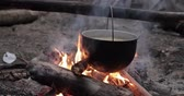 kemping : Old Retro Camp Saucepan Boiled Water For Soup Preparation On A Fire In Forest. Flame Fire Bonfire At Summer Evening